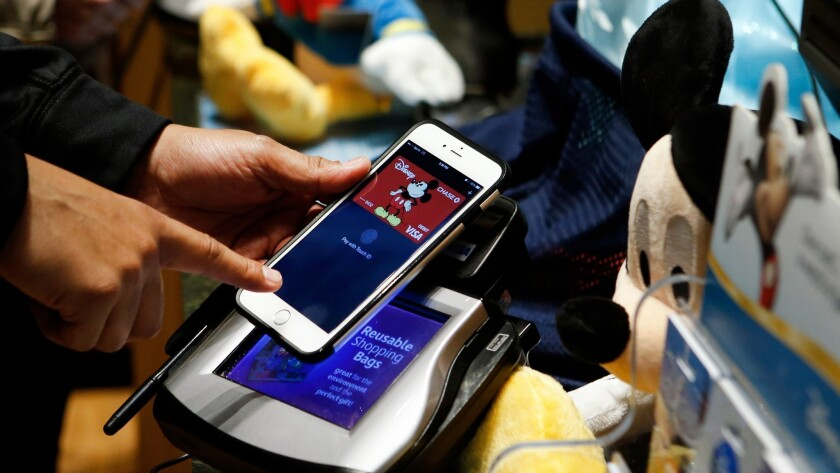 Apple Pay is shown here being used at Disney Store. Apple Pay and other digital wallets are now usab