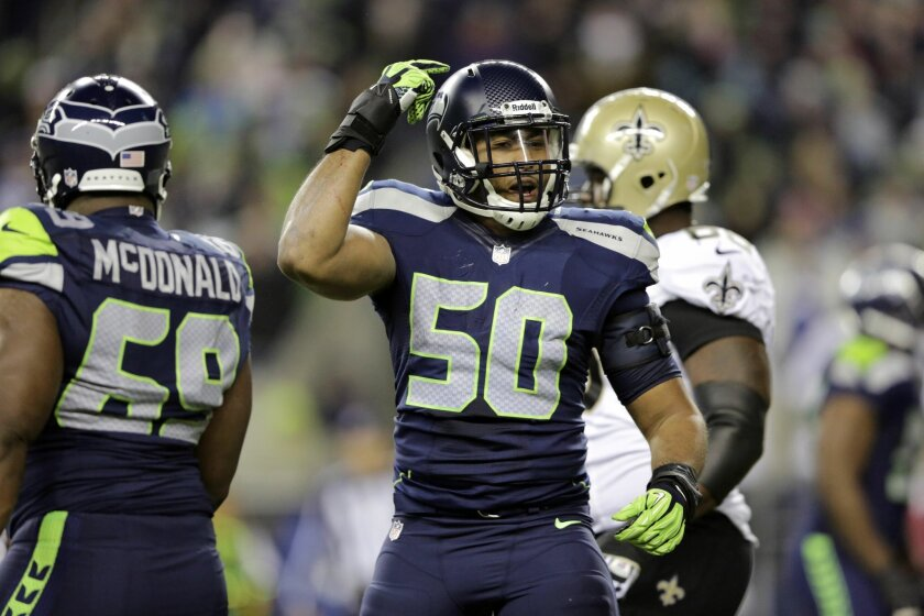 Seattle Seahawks K.J. Wright (50) gestures after a play against the New Orleans Saints in the second half of an NFL football game, Monday, Dec. 2, 2013, in Seattle. (AP Photo/Scott Eklund)