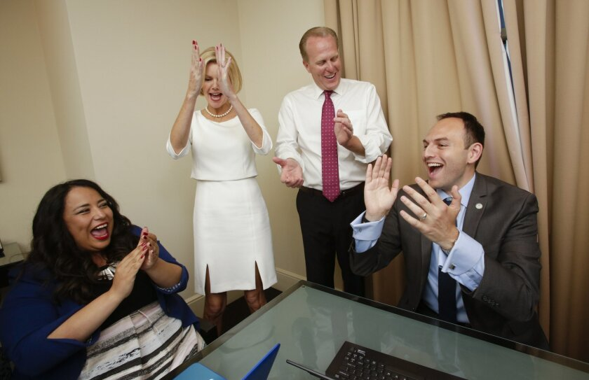 Campaign Manager Francis Barraza, Katherine Faulconer, San Diego Mayor Kevin Faulconer, along with campaign aide and Deputy Chief of Staff and Chief of Communications, Matt Awbrey, right, rejoice as the first election returns come in.