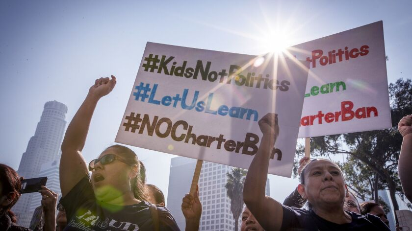 More than 1,000 charter-school supporters held a protest Tuesday outside LAUSD headquarters as the L.A. Board of Education voted on a resolution calling on state officials to support a local moratorium on charter schools. The board also approved the teachers' contract.