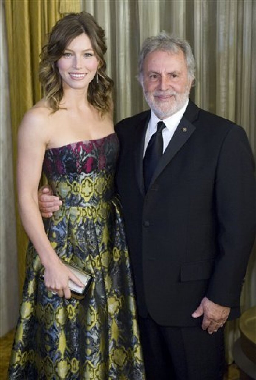 Actress Jessica Biel and Academy President Sid Ganis, right, pose for photographers at the 81st Annual Academy of Motion Picture Arts and Sciences' Scientific and Technical Awards, Saturday, Feb. 7, 2009, in Beverly Hills, Calif. (AP Photo/Gus Ruelas)