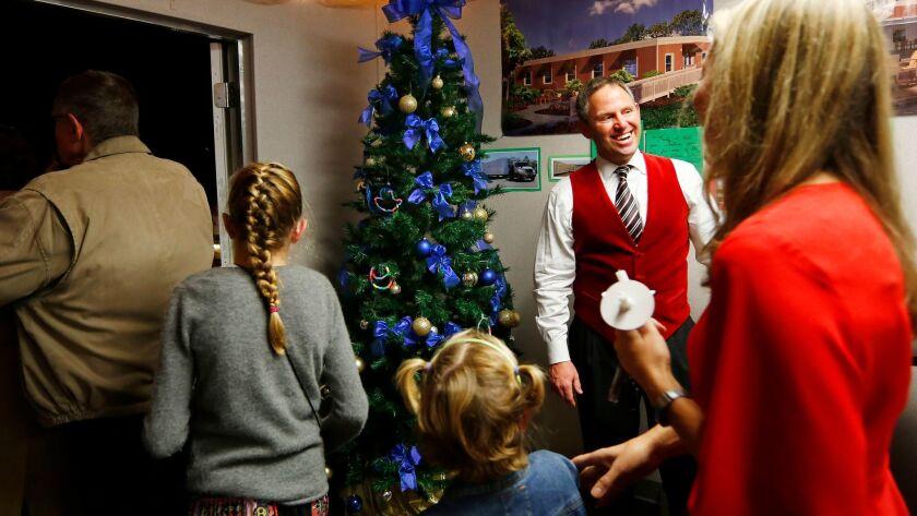 Elder Jon Vanderpool greets parishioners of Christ Presbyterian Church on Christmas Eve in Carlsbad.