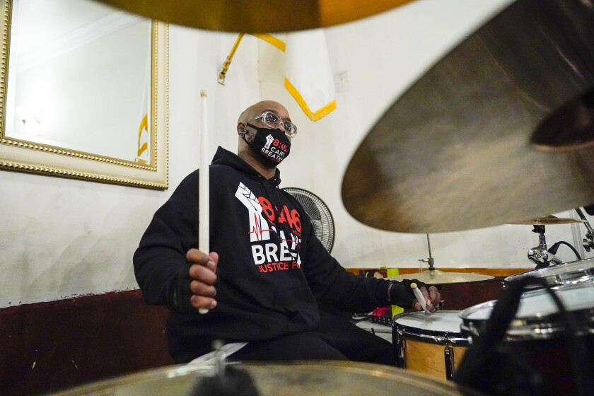 Terrence Floyd, brother of George Floyd, plays drums with other artists recording protest songs