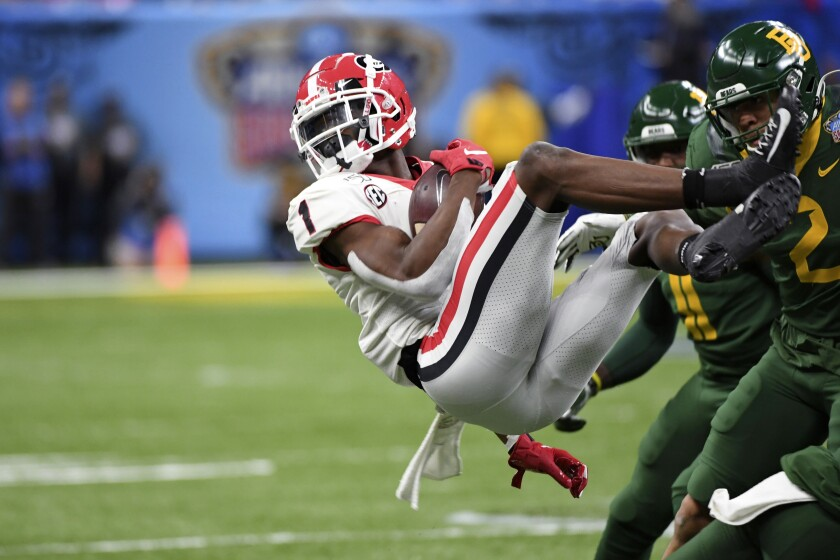 Georgia wide receiver George Pickens (1) is upended by Baylor linebacker Blake Lynch (2) during the first half of the Sugar Bowl NCAA college football game in New Orleans, Wednesday, Jan. 1, 2020. (AP Photo/Bill Feig)