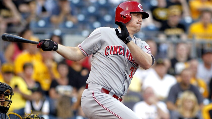 Reds right fielder Jay Bruce delivers a run-scoring single against the Pirates during a game June 23 in Pittsburgh.