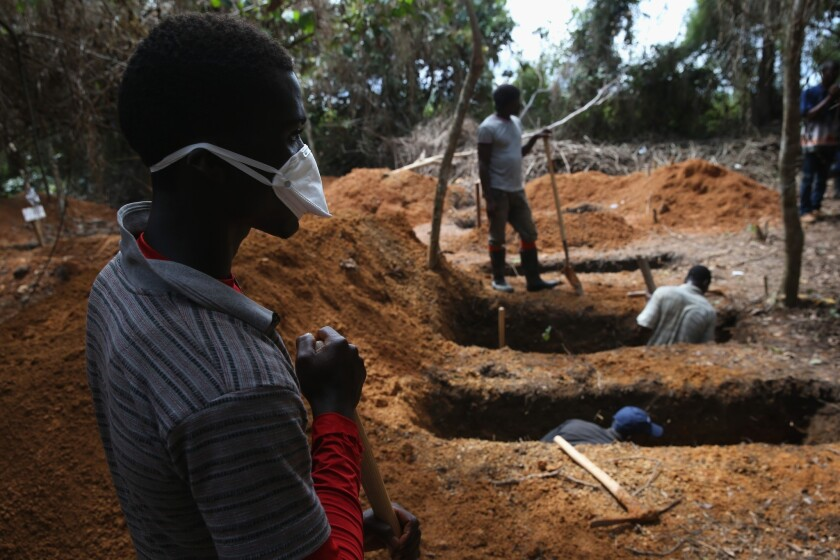 Grave diggers prepare for new Ebola victims outside a treatment center near Gbarnga in central Liberia on Oct. 7.