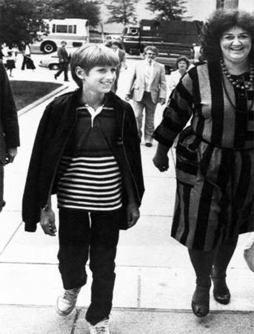 Jeanne White-Ginder, right, shown with son Ryan White in 1985 after he was diagnosed with AIDS, said she is alarmed by Mike Huckabee's statements about AIDS. Ryan died in 1990 at age 18.
