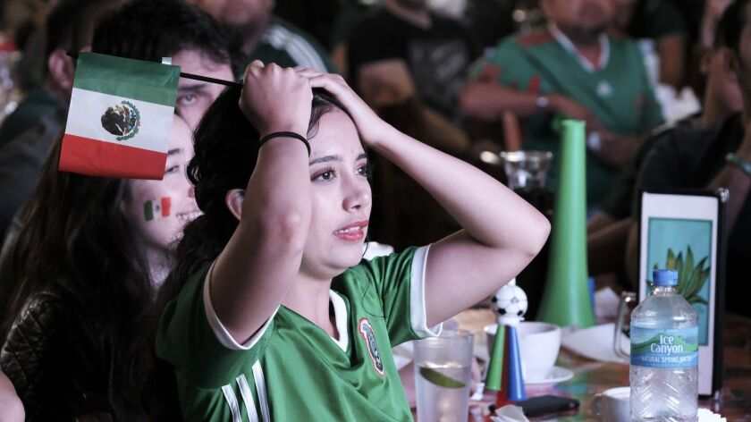 Mexico soccer fan Monse Maldonado reacts after Brazil scored during the World Cup match between Mexi