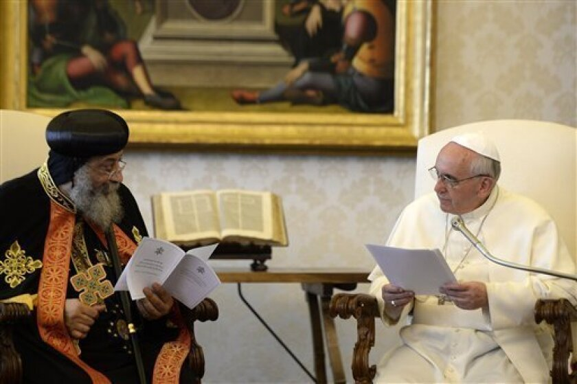 Pope Francis, right, listens to Coptic Orthodox Church of Egypt Pope Tawadros II during their private audience in the pontiff's library, at the Vatican, Friday, May 10, 2013. The head of the Coptic Orthodox Church of Egypt, Pope Tawadros II, called on Pope Francis on Friday in the first such meeting in 40 years. The occasion was to mark the anniversary of the signing of a declaration for improving ties between the two churches between Pope Paul VI and Tawadros' predecessor, Pope Shenouda III. (A