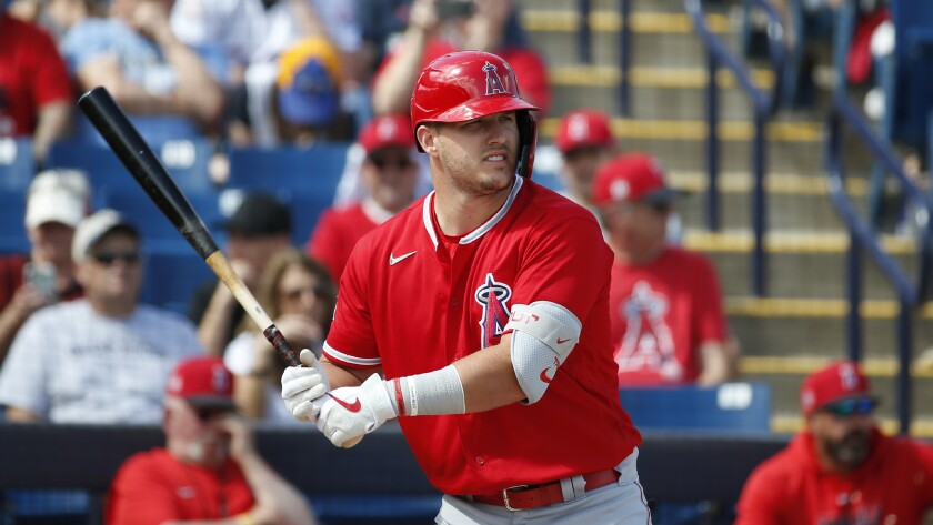 Angels center fielder Mike Trout bats during a spring training game against the Milwaukee Brewers.