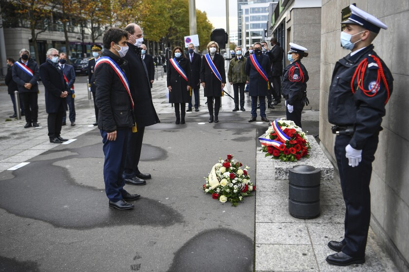 Saint-Denis Mayor Mathieu Hanotin, left, and French Prime Minister Jean Castex participate in a wreath-laying ceremony