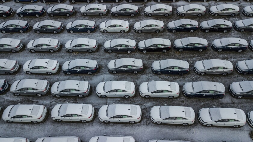 FILE - In this Dec. 5, 2018 file photo, hundreds of Chevrolet Cruze cars sit in a parking lot at Gen