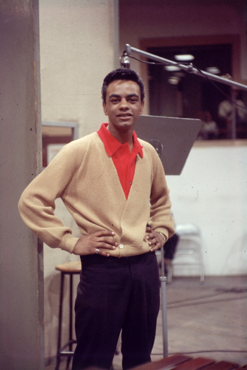 Johnny Mathis, seen here at the age of 22, recording in New York City in the late 1950s.