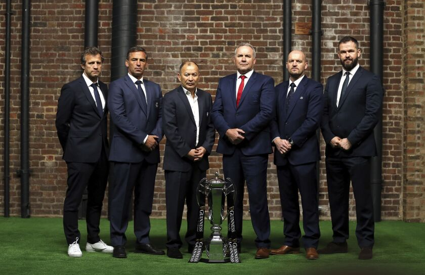 France head coach Fabien Galthie, Italy head coach Franco Smith, England head coach Eddie Jones, Wales head coach Wayne Pivac, Scotland's head coach Gregor Townsend and Ireland head coach coach Andy Farrell pose for a photo with the Six Nations trophy during the Six Nations rugby launch in London, Wednesday Jan. 22, 2020. (Steven Paston/PA via AP)