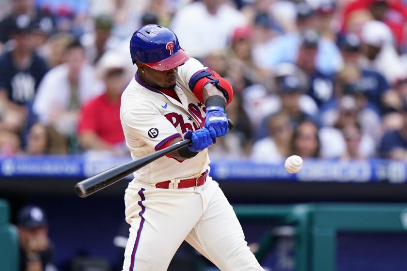 Philadelphia Phillies' Jean Segura hits a two-run single off New York Yankees pitcher Domingo German during the second inning of a baseball game, Sunday, June 13, 2021, in Philadelphia. (AP Photo/Matt Slocum)