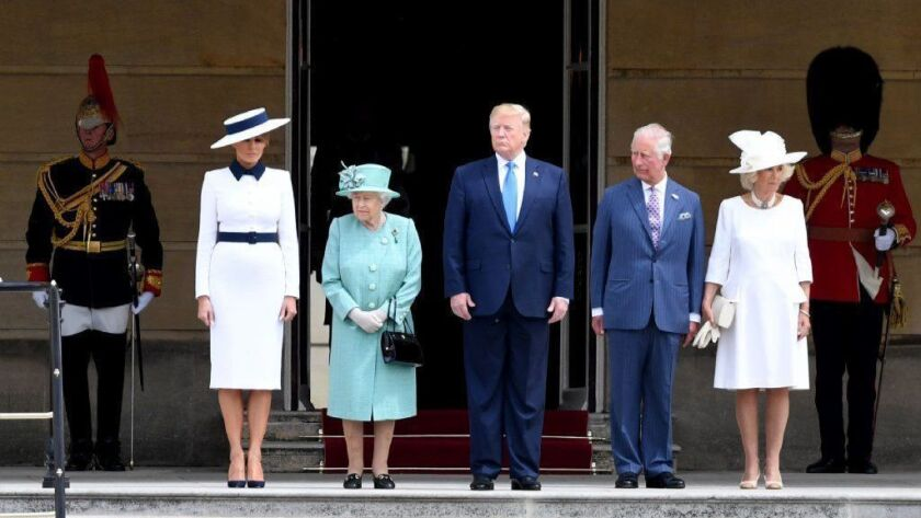 Observers noticed striking similarities between the dresses worn by First Lady Melania Trump, front far left, and the Duchess of Cornwall, front far right, who appeared Monday at Buckingham Palace with Queen Elizabeth II, President Donald Trump and Prince Charles.