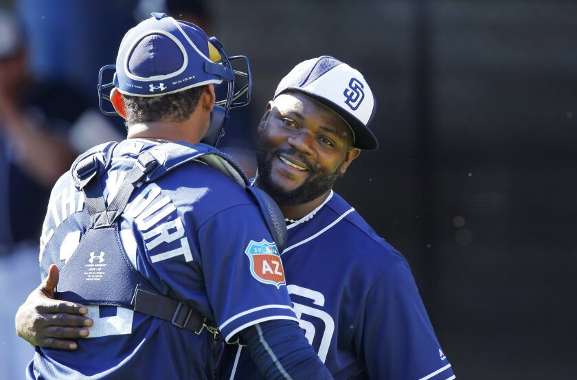 San Diego Padres Fernando Rodney hugs catcher Christian Bethancourt after pitching during a spring training practice.