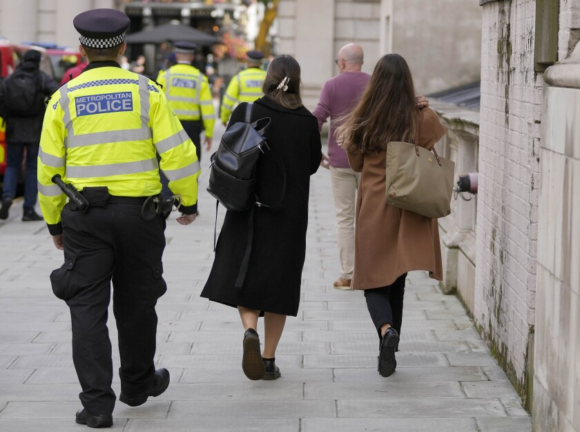 Police officers on patrol, in Westminster, London, Friday, Oct. 1, 2021. Police in Britain's capital are desperately trying to regain the trust of women after revelations about how a serving officer used his position to abduct, rape and murder a young marketing executive, taking the unprecedented step of warning women and girls how to protect themselves during interactions with police.( AP Photo/Frank Augstein)