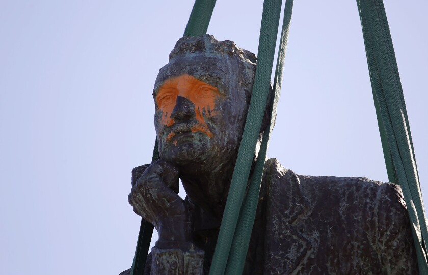 FLE - In this April 9, 2015, file photo, the statue of British colonialist Cecil Rhodes, is removed from the campus at the Cape Town University, Cape Town, South Africa. New campaigns in the U.S. and Europe to pull down monuments to slave traders and colonial rulers are now following Africa's lead. (AP Photo/Schalk van Zuydam, File)
