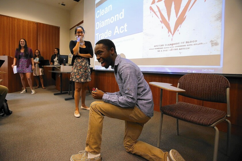 Donald Abram and Brenda Benitez act out a light-hearted skit for their team's presentation on the Clean Diamond Trade Act, which they wrote a Wikipedia entry on for a class assignment at Pomona College.