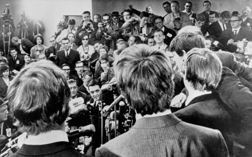 """The Beatles face the media at JFK Airport after their arrival in America on Feb. 7, 1964. The band's early years will be the focus of a forthcoming Ron Howard-directed documentary called """"The Beatles: Eight Days a Week - the Touring Years."""""""