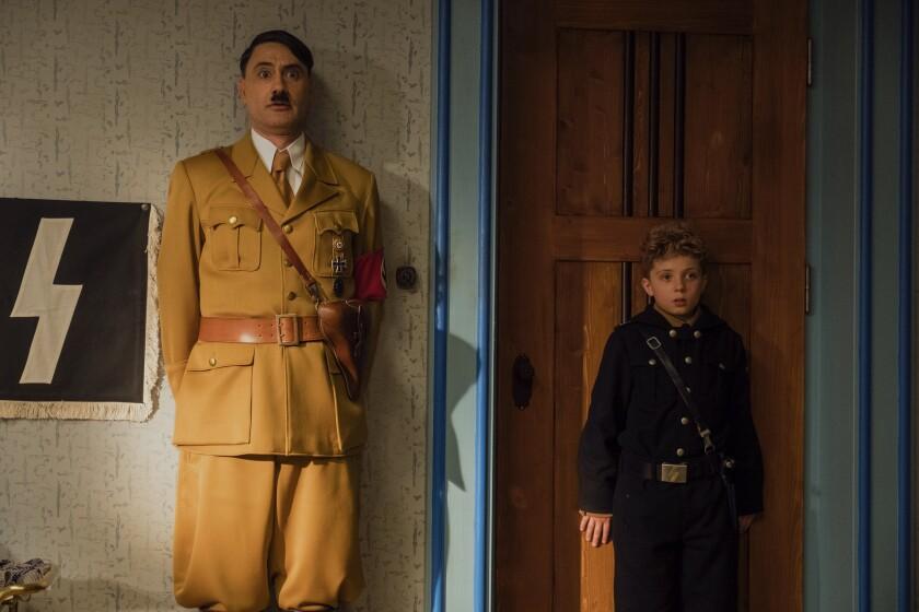 "Taika Waititi as young Roman Griffin Davis' imaginary friend and hero, Adolf Hitler, in ""Jojo Rabbit."""