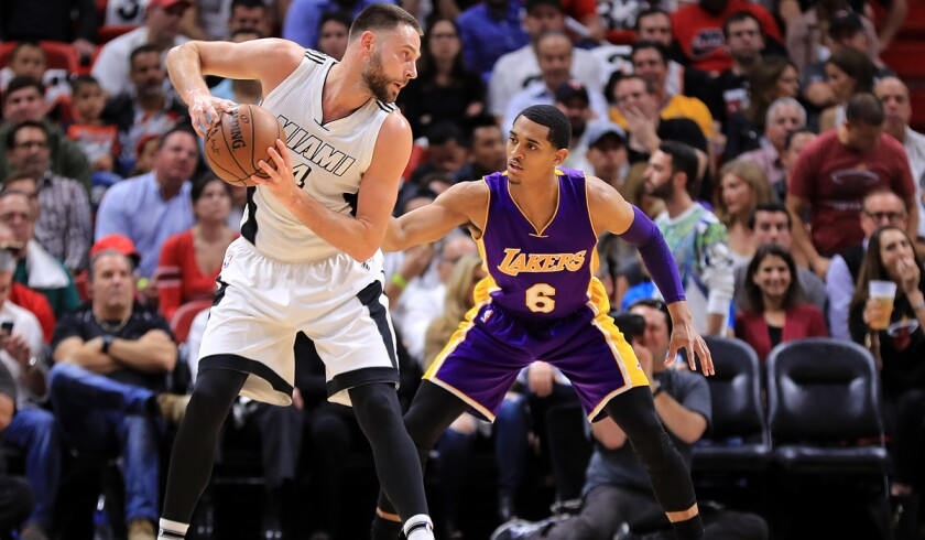 The Miami Heat's Josh McRoberts, left, posts up Lakers' Jordan Clarkson during the game Thursday.