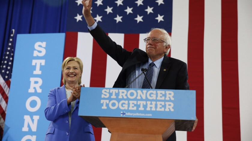 Sen. Bernie Sanders endorses Hillary Clinton for president at a rally in Portsmouth, N.H., on Tuesday.