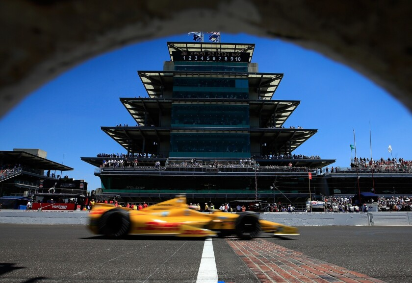 Ryan Hunter Reay guides his car arcoss the finish line in front of the pagoda-style center at Indianapolis Motor Speedway on May 25, 2014.