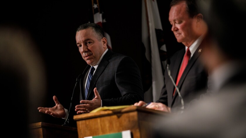 Retired Sheriff's Lt. Alex Villanueva debates L.A. County Sheriff Jim McDonnell at an event hosted by the Professional Peace Officers Association, in Los Angeles, Calif., on July 23, 2018.