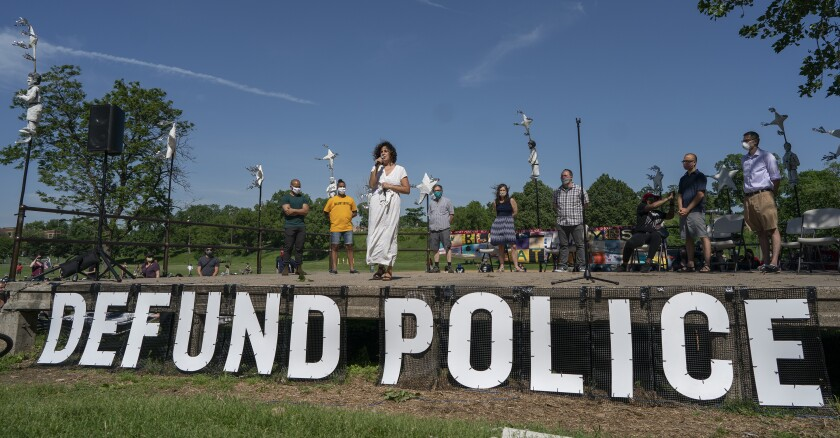 """FILE - In this Sunday, June 7, 2020, file photo, Alondra Cano, a City Council member, speaks during """"The Path Forward"""" meeting at Powderhorn Park in Minneapolis. The focus of the meeting was the defunding of the Minneapolis Police Department. Members of the Minneapolis City Council are pledging a thoughtful approach to their proposal to dismantle the city's police department following the killing of George Floyd. (Jerry Holt/Star Tribune via AP, File)"""