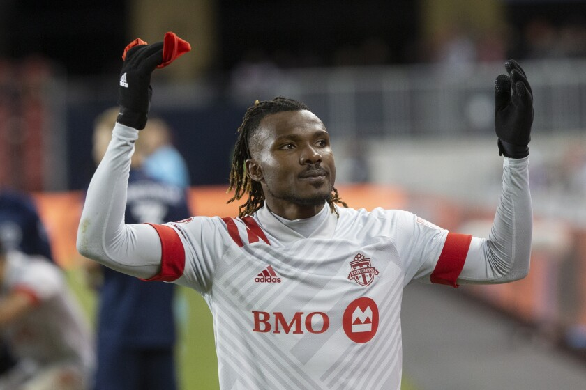 Toronto FC forward Ifunanyachi Achara (99) gestures to fans as he is taken out of the game during the last minutes of the second half of an MLS soccer game against the New York City FC in Toronto, Saturday March 7, 2020. (Chris Young/The Canadian Press via AP)