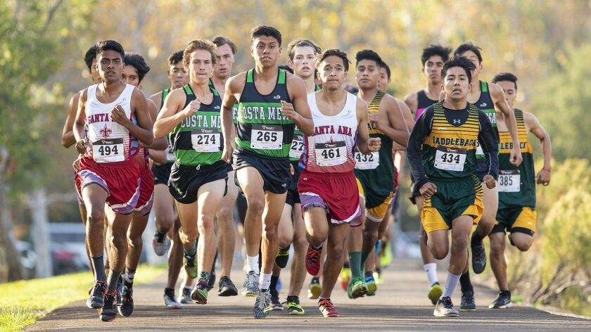 Costa Mesa's Riley Mitchell, left, and Kevin Cortez lead the pack at the start of the boys' race dur