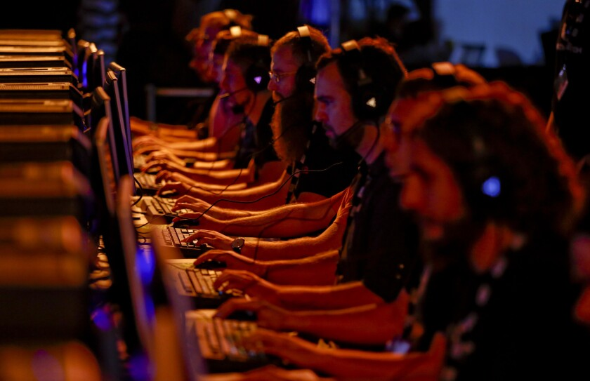 Game players compete during the BlizzCon convention held by Blizzard Entertainment, a division of Activision Blizzard, in November at the Anaheim Convention Center.