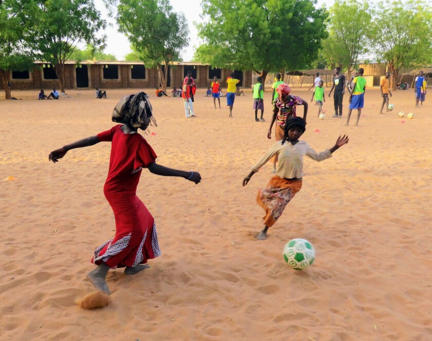 Children play at the Refugees United Soccer Academy in Eastern Chad in 2015.