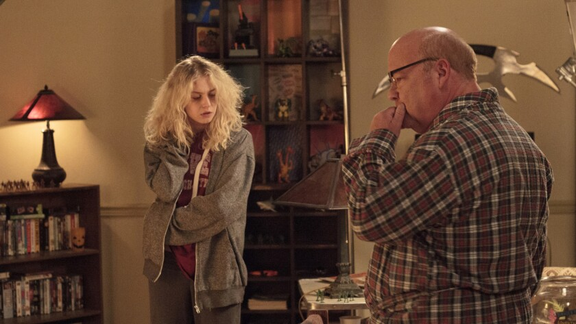"(L-R) Penelope Mitchell as Jennifer and Kyle Gass as Terry in the horror film ""APARTMENT 212."" Credi"