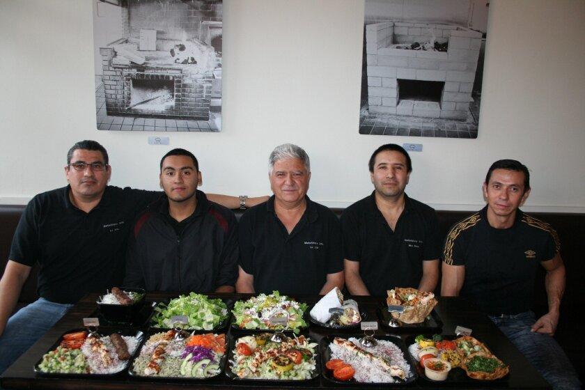 Tony Marashi, center, opened Marketplace Grille in Piazza Carmel in February 2014.