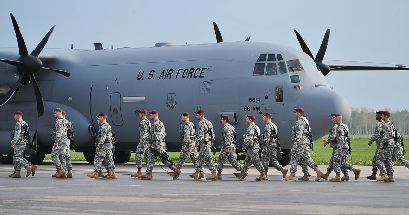 The Pentagon has sent U.S. paratroopers to Poland in response to Russian aggression in neighboring Ukraine, as seen in this photo taken at the air base in Swidwin last week. A poll released Monday shows Americans oppose military help for Ukraine by a 2-1 margin.