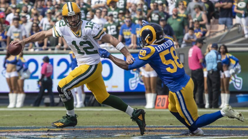 LOS ANGELES, CALIF. -- SUNDAY, OCTOBER 28, 2018: Rams Cory Littleton, right, sacks Aaron Rodgers, l