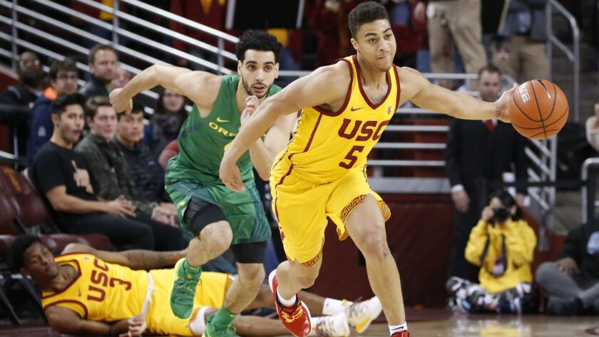 Southern California's Derryck Thornton (5) steals a ball from Oregon's Ehab Amin (4) during an NCAA