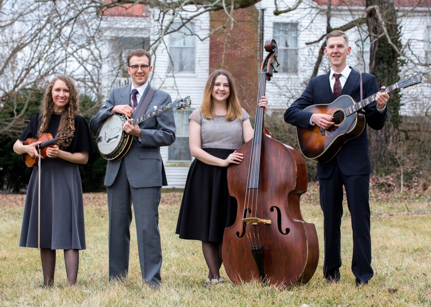 Violinist Corrina Rose Logston (left) and banjo player Jeremy Stephens (second from left) are husband-and-wife musicians. The other members of their award-winning bluegrass band, High Fidelity, are bassist Vickie Vaughn and guitarist Daniel Amick.