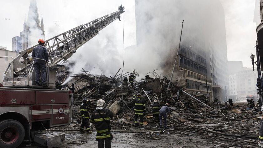 "S""o Paulo, Brazil. 05/03/18. Firemen cooling the debris after Wilton Paes de Almeida building coll"