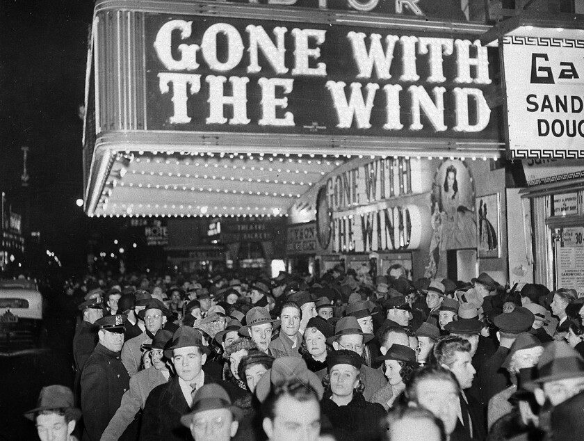 """FILE - In this Dec. 19, 1939 file photo, a crowd gathers outside the Astor Theater on Broadway during the premiere of """"Gone With the Wind"""" in New York. HBO Max has temporarily removed """"Gone With the Wind"""" from its streaming library in order to add historical context to the 1939 film long criticized for romanticizing slavery and the Civil War-era South. (AP Photo)"""