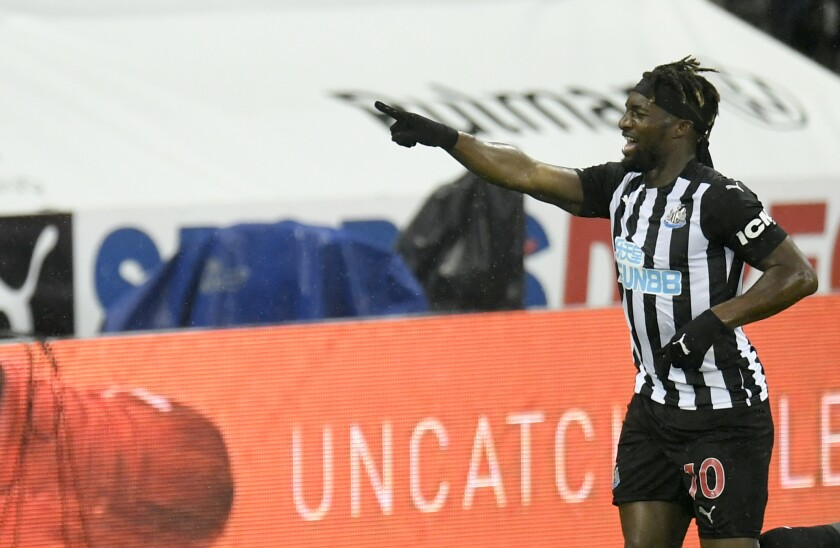 Newcastle's Allan Saint-Maximin celebrates after scoring his side's opening goal during the English Premier League soccer match between Newcastle United and Burnley at St. James' Park in Newcastle, England, Saturday, Oct. 3, 2020. (Peter Powell/Pool via AP)