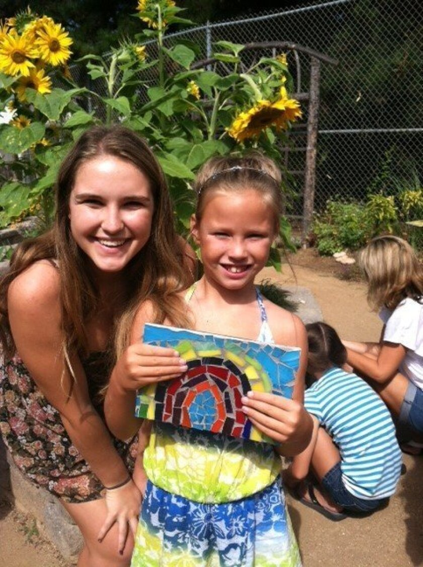 Isabelle Kaplan, left, with a student at the 2013 Art for Autism Summer Camp in Solana Beach. CREDIT: Autism Tree