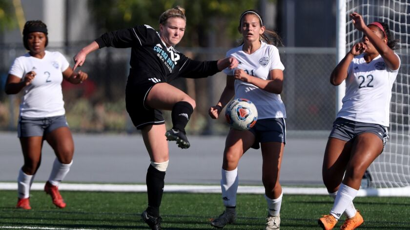 Corona del Mar High School girls' soccer player #12 Megan Chelf attempts a shot on goal in game vs.