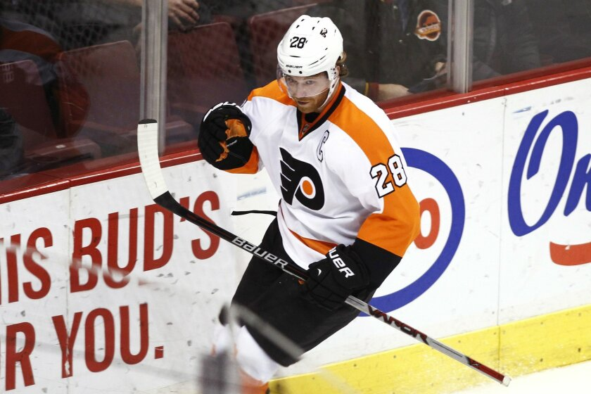 Philadelphia Flyers' Claude Giroux celebrates his goal against the Vancouver Canucks during the second period of an NHL hockey game in Vancouver, British Columbia, Monday, Nov. 2, 2015. (Ben Nelms/The Canadian Press via AP) MANDATORY CREDIT