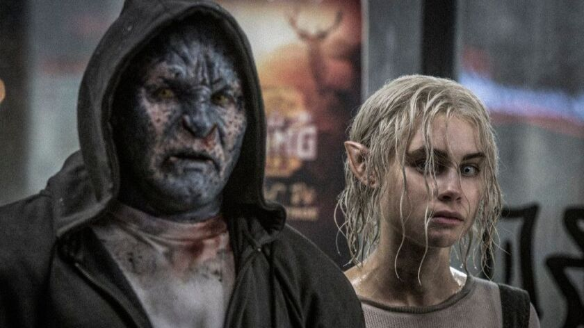 """Joel Edgerton and Lucy Fry in a scene from the movie """"Bright."""""""