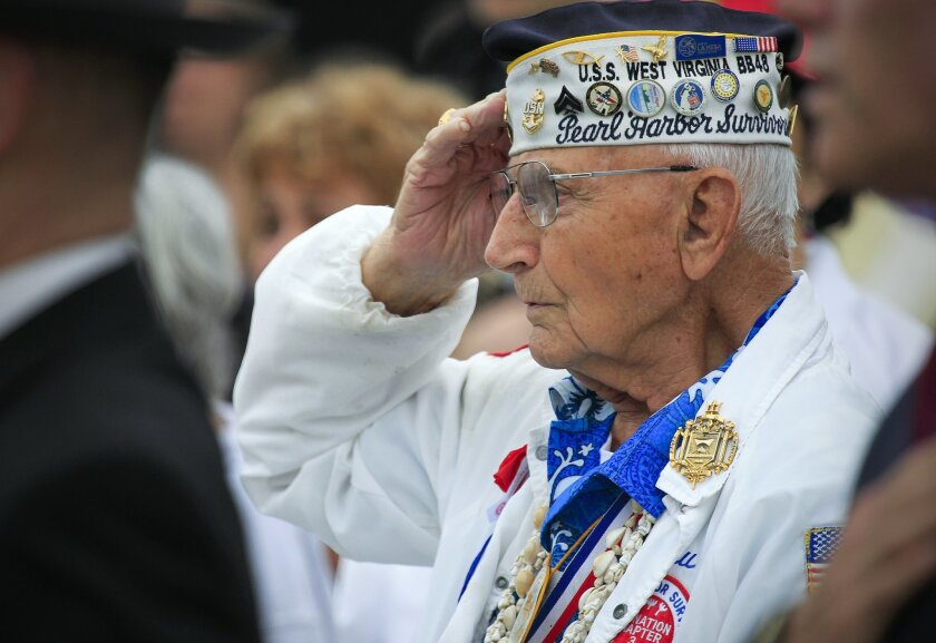 Pear Harbor Survivor Stu Hedley salutes   during the annual Veterans Wreath Remembrance Ceremony for Memorial Day weekend at the USS Midway Museum.