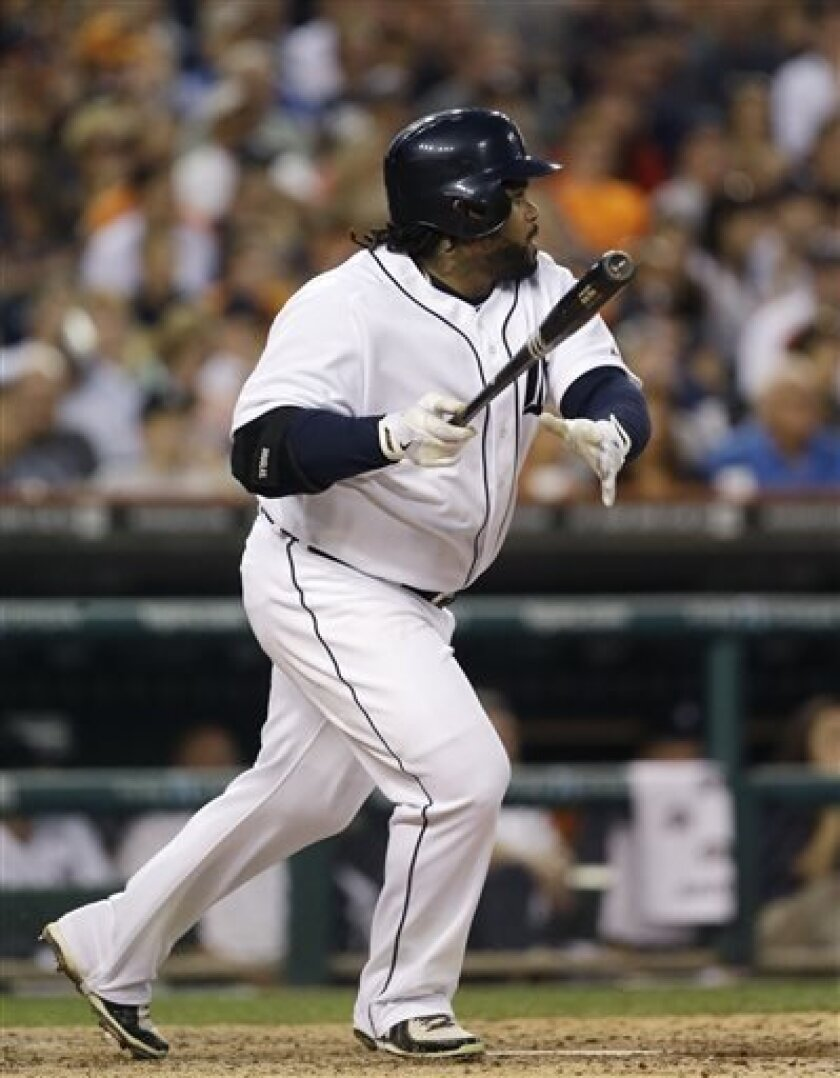 Detroit Tigers' Prince Fielder singles to left field and drives in Torii Hunter from second during sixth inning of a baseball game against the Chicago White Sox in Detroit, Wednesday, July 10, 2013. (AP Photo/Carlos Osorio)